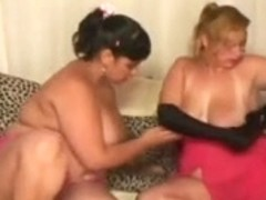 2 big beautiful woman lesbo on sofa with nylons