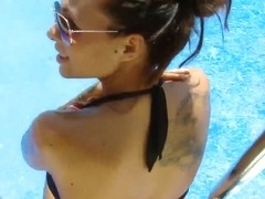 Domino poses in sexy black bikini and shows her tits