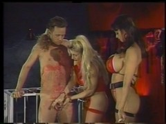 two smokin' hawt mistresses in act with a serf boy