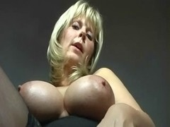 Dark skinned MILF uses sex toys to masturbate her clit