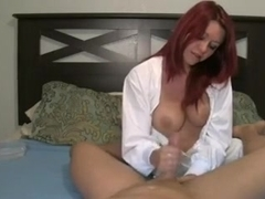 My redhead busty wife playing with my strapon and taking it slow