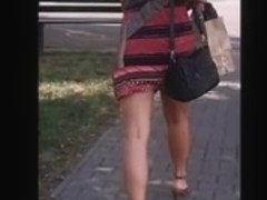 Blonde girl with sexy legs in high heels