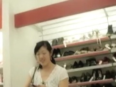 Asian cutie makes upskirt magic in a shoe store