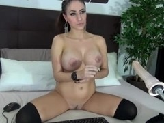 Perfect busty babe nailed by a fuck machine
