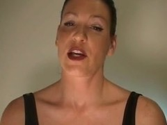Hot looking dominatrix talks dirty over the webcam
