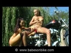 Brunette uses vibrator on bike