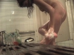 Gal washing her legs and pussy on hidden shower cam