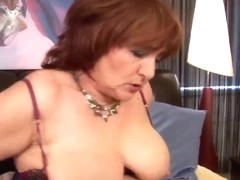 Fat granny probes her old vagina with a sextoy