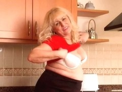 Bulky granny in size XXL pants undresses off