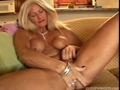 Hot cougar slides out of her pants and plays with her soaked