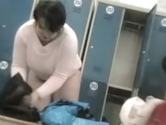 Big dark haired fem with massive soft boobs in locker room