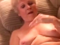Nice-Looking non-professional grandma slides out of her pants and shows