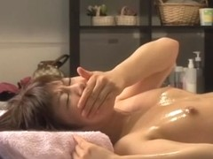 Great Japanese sex caught by a hidden cam in massage room
