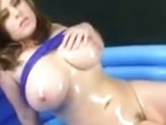 Brunette Hair Getting Oiled Up