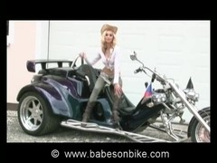 Cowgirl gets naked on bike
