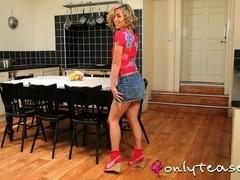 Perfect blonde Melanie strips in the kitchen