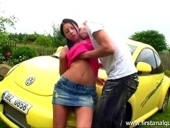 Teenage gal receives anal sex near her yellow car