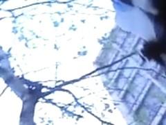 Sassy chick filmed by a naughty street voyeur
