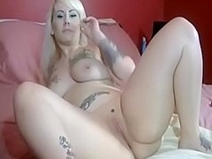 Tattooed cutie touching her juicy vagina