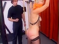 Tied blonde gets spanked and dildoed by her man