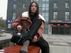 Beautiful Teenager Black Nylon Soles Sitting On A Bench